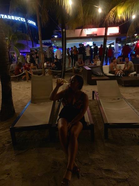 girl drinking at beach bar