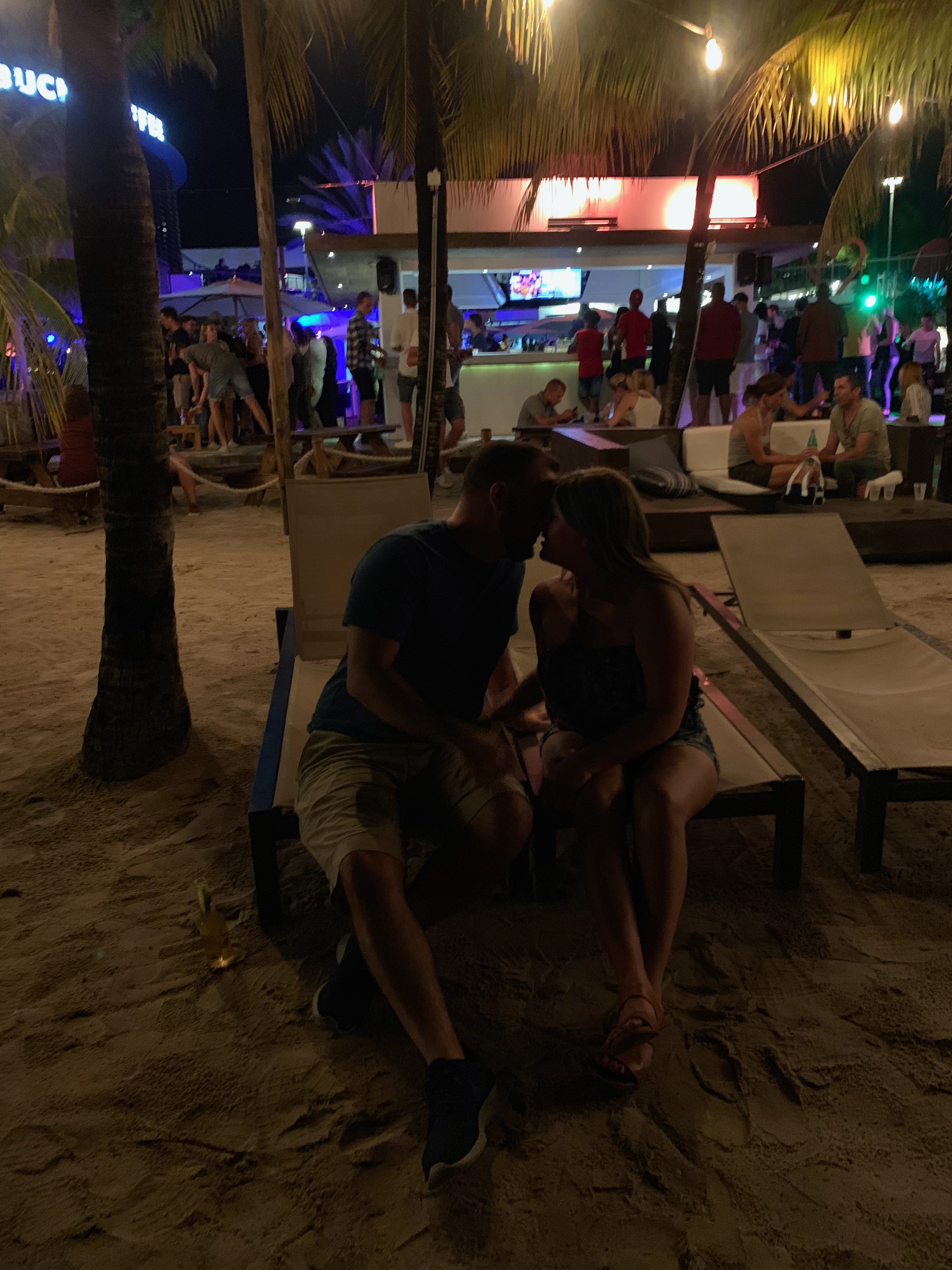 couple kissing at night on beach