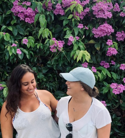 two girls laughing with flowers